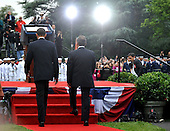 United States President Barack Obama (L) and Mexican President Felipe Calderon arrives for a welcoming ceremony on the South Lawn of the White House in Washington on Wednesday, May 19, 2010. .Credit: Kevin Dietsch - Pool via CNP
