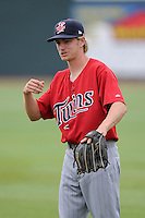 Second baseman Will Hurt (4) of the Elizabethton Twins warms up before a game against the Johnson City Cardinals on Sunday, July 27, 2014, at Howard Johnson Field at Cardinal Park in Johnson City, Tennessee. The game was suspended due to weather in the fifth inning. (Tom Priddy/Four Seam Images)
