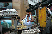 a man prepairing chowmein at a street food stall in New market  area of Kolkata. Street food stalls are serving the office goers for decades. All kind of Indian foods are available on the street at an affordable price. They sale them openly. Street food stalls are another results of unempoloyment and over poppulation. They serve millions of people in India. Kolkata, West Bengal,  India  7/18/2007.  Arindam Mukherjee/Landov
