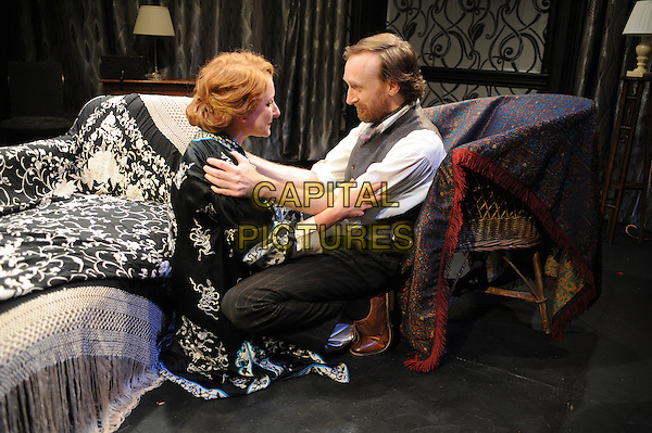 LONDON, ENGLAND - JULY 15: Dorothea Myer-Bennett and Jamie de Courcey appear in a new theatre production of This Was A Man, directed by Belinda Lang - a previously unseen play by Noel Coward about a successful painter who becomes aware of his wife's infidelity, Finborough Theatre on July 15, 2014 in London, England<br /> CAP/BEL<br /> &copy;Tom Belcher/Capital Pictures