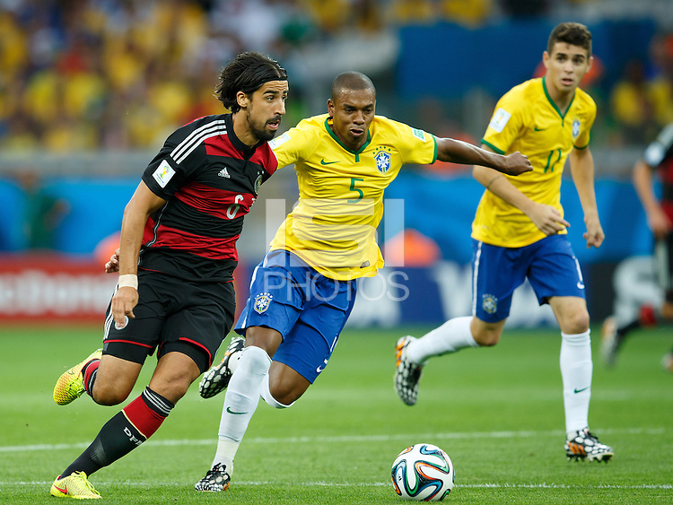 Sami Khedira of Germany takes on Fernandinho of Brazil