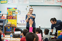 Alice Feng '20 and Alexandra Pfleegor '20 (glasses) present.<br /> Occidental students give presentations on STEM (science, technology, engineering, and mathematics) to students at Buchanan Street Elementary School in the Highland Park area of Los Angeles, Calif., March 8, 2018.<br /> In 30-minute presentations to kindergarten to sixth-grade students, Boundless Brilliance's teams of college students, all women currently attending Occidental, go into classrooms to create excitement about science. Through simple experiments (such as building a bridge between two chairs using only newspapers and tape) and a message couched in confidence, respect, and teamwork, their message to everyone—and young girls in particular—is simple: You are brilliant and you can be a scientist if you want to be.<br /> (Photo by Marc Campos, Occidental College Photographer)