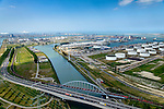 Nederland, Zuid-Holland, Rotterdam, 10-06-2015; Europoort, Dintelhavenbruggen over Hartelkanaal en Dintelhaven. Betuweroute en A15, op de spoorbrug een goederentrein. Rechts Shell Europoort terminal, Beneluxhaven met P&amp;O terminal, BP Rafiinaderij en Maasvlakte aan de horizon.<br /> Industrial landscape in Port of Rotterdam with bridges, roads, railroads.<br /> <br /> luchtfoto (toeslag op standard tarieven);<br /> aerial photo (additional fee required);<br /> copyright foto/photo Siebe Swart
