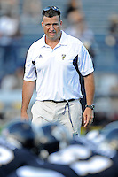 17 September 2011:  FIU Football Head Coach Mario Cristobal watches as his players warm up prior to the game.  The FIU Golden Panthers defeated the University of Central Florida Golden Knights, 17-10, at FIU Stadium in Miami, Florida.