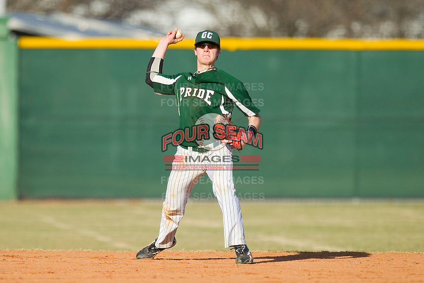 Shortstop Austin Catherina #3 of the Greensboro College Pride makes a throw to first base against the Washington & Lee Generals at War Memorial Stadium on February 13, 2011 in Greensboro, North Carolina.  Photo by Brian Westerholt / Four Seam Images