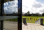 Keswick 1 Kendal 1, 15/04/2017. Fitz Park, Westmoreland League. Keswick players warming up, seen through the clubhouse doors. Photo by Paul Thompson.