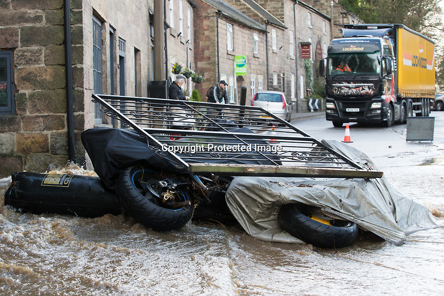 """15/01/19<br /> <br /> Motorcycles and fencing are knocked over by the strength of the flood water.<br /> <br /> Ian Busting surveys the damage to his home and his wife's florist business. He said: """"My wife is devastated. Everything's ruined. Someone will have to pay for all this. We have a large corporate order which needs to go out on Thursday. We'll have to find a way of completing the order.""""<br /> <br /> A giant spout of water fires into the sky as high as a tall tree after locals say a farmer burst a water main while putting in a fence post this morning. The torrent of water near Shaws Lane, has caused flooding in the nearby village of Milford, Derbyshire. <br /> <br /> <br /> All Rights Reserved, F Stop Press Ltd.  (0)7765 242650  www.fstoppress.com rod@fstoppress.com"""