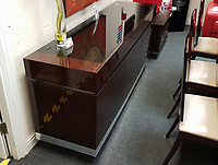 Pictured: The sideboard at the British Heart Foundation charity shop in Swansea, Wales, UK. Wednesday 12 April 2017<br /> Re: A mystery Swansea woman has donated £16,000 worth of furniture to a charity shop.<br /> The British Heart Foundation shop in Kingsway in Swansea has benefitted from the haul.<br /> Some of the furniture is so new, that similar items are still for sale with the original retailer; Furniture Village.<br /> The haul includes a side board, a display cabinet, two two-seater sofas, a three seater sofa and dining table complete with six chairs.<br /> The dining table is listed online with Furniture Village for £1,865, the display cabinet for £1,865, and a pair of the six dining chairs for £1065.<br /> The British Heart Foundation will be selling the items for probably around a quarter of the original value.