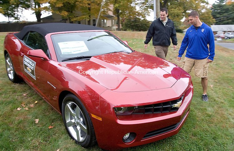PLYMOUTH, CT. 02 October 2012-100212SV03-From left, Bruce Novicky of Terryville Chevrolet and Rich Marsh of the Animal Rescue Foundation check out the 2013 Cameo Convertible that will be auction off October 14th at the Animal Rescue Foundation auction, in Terryville Tuesday..Steven Valenti Republican-American