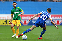 Preston North End's Joe Rafferty plays the ball round Wigan Athletic's Kal Naismith<br /> <br /> Photographer David Shipman/CameraSport<br /> <br /> The EFL Sky Bet Championship - Wigan Athletic v Preston North End - Monday 22nd April 2019 - DW Stadium - Wigan<br /> <br /> World Copyright © 2019 CameraSport. All rights reserved. 43 Linden Ave. Countesthorpe. Leicester. England. LE8 5PG - Tel: +44 (0) 116 277 4147 - admin@camerasport.com - www.camerasport.com
