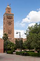 Marrakesh, Morocco.  Koutoubia Minaret, 12th. Century, Woman Sleeping on Bench on right.