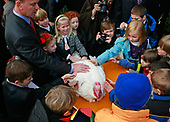 Children from Cloverly Elementary School in Silver Spring, Maryland gather around a turkey named Pumpkin after United States President George W. Bush granted it a pardon during the annual White House Turkey Presidential Pardon presentation in the Rose Garden at the White House November 26, 2008 in Washington, DC. Later today Pumpkin will be flown to Disneyland and be an honorary grand marshal of Disney's Thanksgiving Day Parade in California.  The annual White House tradition that has held strong since President Harry S. Truman first pardoned a bird in 1947.  <br /> Credit: Mark Wilson / Pool via CNP