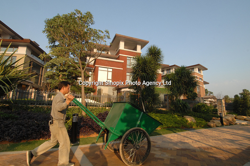 A worker at the World is Mine Development, Dongguan, China. Ex Uk PM Tony Blair was offered a villa worth 2.5 million sterling and paid 500,000 US$ for 3 hours work in south China..10 Nov 2007