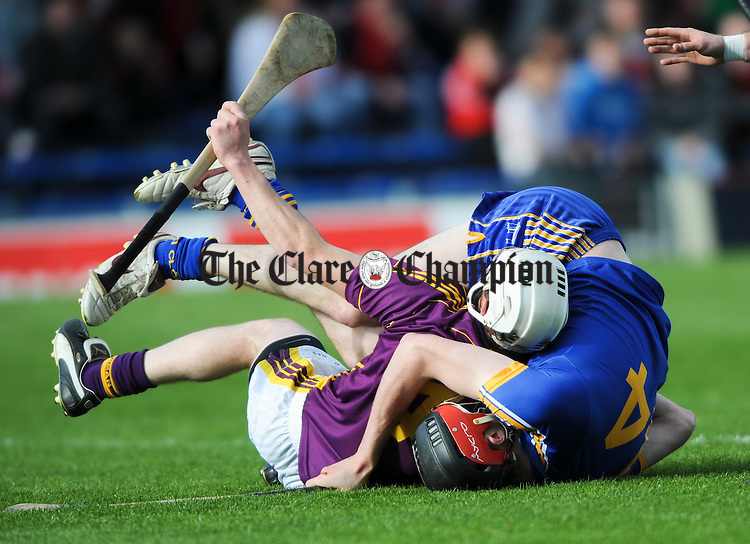 "Darach Honan of Clare and Ciaran Kenny of Wexford play some ""ground hurling"" during the Division 2 National League final at Thurles. Photograph by John Kelly."
