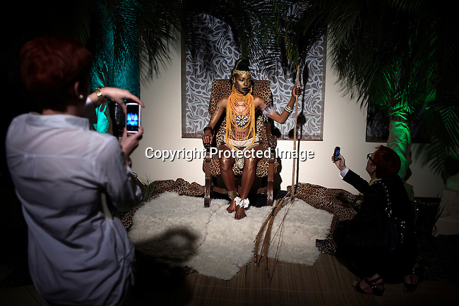 MAPUTO, MOCAMBIQUE - JUNE 27: A model for the fashion designer Taibo Bacar sits during a fashion show installation on June 27, 2013 at Polana hotel in Maputo Mozambique. Taibo is one of the youngest and most celebrated African designers and he has shown his designs around Africa and the world. (Photo by: Per-Anders Pettersson)