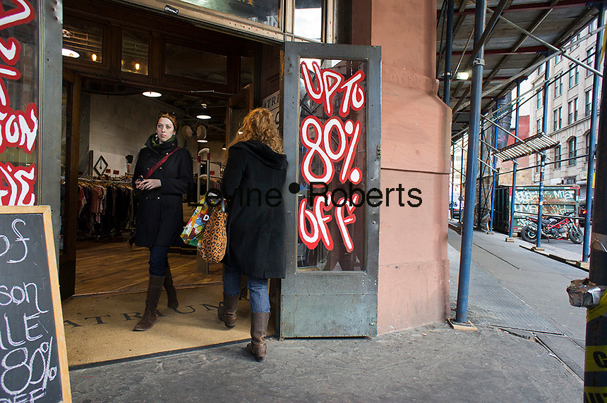 A women's clothing store on Broadway in Greenwich Village  in New York advertises its 80 percent off sale on Saturday, January 28, 2012. Because of an unseasonably warm winter many stores are stuck with unsold winter merchandise which they want to get rid of.(© Richard B. Levine)