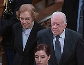 Former United States President Jimmy Carter, right, and former first lady Rosalynn Carter, left, depart following the National funeral service in honor of the late former US President George H.W. Bush at the Washington National Cathedral in Washington, DC on Wednesday, December 5, 2018.<br /> Credit: Ron Sachs / CNP<br /> (RESTRICTION: NO New York or New Jersey Newspapers or newspapers within a 75 mile radius of New York City)