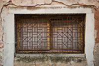 A grille on a narrow street in the town of Rovinj, Istria County, Croatia