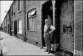 "John Collins in  May 1999: one of the last residents remaining in a street in Higher Broughton, Salford, an area suffering from ""low demand"". The houses have since been demolished and rebuilt by a housing association."