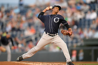 Starting pitcher Daniel Ramos (11) of the Charleston RiverDogs delivers a pitch in a game against the Greenville Drive on Friday, April 27, 2018, at Fluor Field at the West End in Greenville, South Carolina. Greenville won, 5-4. (Tom Priddy/Four Seam Images)