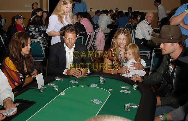 BROOKE BURKE, DAVID CHARVET, CHRISTOPHER BACKUS & MIRA SORVINO WITH DAUGHTER MATTEA ANGEL.attends The Celebrity Poker Tournament benefitting The Los Angeles Youth Network held at The Crystal Casino in Comton, LA, California, USA, September 9th 2006..half length sitting at poker table family mom mother father dad child kid gambling playing cards.Ref: DVS.www.capitalpictures.com.sales@capitalpictures.com.©Debbie VanStory/Capital Pictures