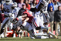 NWA Democrat-Gazette/CHARLIE KAIJO Arkansas linebacker De'Jon Harris (8) tackles Mississippi State quarterback Tommy Stevens (7), Saturday, November 2, 2019 during the first quarter of a football game at Donald W. Reynolds Razorback Stadium in Fayetteville. Visit nwadg.com/photos to see more photographs from the game.
