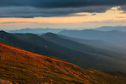 Mount Washington Cog Railroad at sunset from along the Appalachian Trail near Mount Clay in the White Mountains, New Hampshire USA during the summer months.