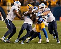 The North Carolina defense gang tackes a Pitt ball carrier. The North Carolina Tarheels defeated the Pitt Panthers football team 34-31 at Heinz Field, Pittsburgh, Pennsylvania on November 9, 2017.