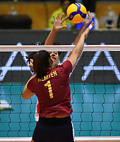BOGOTÁ-COLOMBIA, 09-01-2020: Maricarmen Guerrero de Perú, intenta un bloqueo al ataque de balón a Mariyen Serrano de Venezuela, durante partido entre Perú y Venezuela, en el Preolímpico Suramericano de Voleibol, clasificatorio a los Juegos Olímpicos Tokio 2020, jugado en el Coliseo del Salitre en la ciudad de Bogotá del 7 al 9 de enero de 2020. / Maricarmen Guerrero from Peru, tries to block the attack the ball to Mariyen Serrano from Venezuela, from Venezuela, during a match between Venezuela and Peru, in the South American Volleyball Pre-Olympic Championship, qualifier for the Tokyo 2020 Olympic Games, played in the Colosseum El Salitre in Bogota city, from January 7 to 9, 2020. Photo: VizzorImage / Luis Ramírez / Staff.