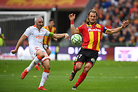 20191102 – Lens , France : Guillaume Gillet (27) of Lens pictured in a duel with Fabien Lemoine (18) of Lorient during a French Ligue 2 soccer game between Racing Club de Lens and FC Lorient , a football game on the 13th matchday in the French second league, on saturday 2 nd of November 2019 at the Stade Bollaert Delelis in Lens , France . PHOTO SPORTPIX.BE   DAVID CATRY