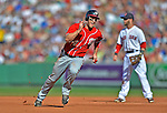 9 June 2012: Washington Nationals outfielder Bryce Harper rounds second and heads on to third during action against the Boston Red Sox at Fenway Park in Boston, MA. The Nationals defeated the Red Sox 4-2 in the second game of their 3-game series. Mandatory Credit: Ed Wolfstein Photo