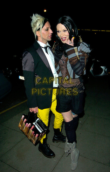 """MICHAEL SIMPSON & PETE BURNS.""""Swarovski Fashion Rocks"""" afterparty, Baglioni, London, England..October 18th, 2007.full length knee high socks yellow jeans denim white shirt gold grey gray dress shorts tattoo married bag profile striped stripes .CAP/CAN.©Can Nguyen/Capital Pictures"""