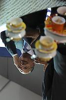 SAO PAULO, SP, 13.01.2014 - COUROMODA - Mesa espelhada reflete imagem do Governador de Sao Paulo, Geraldo Alckmin durante abertura da feira Couromoda, evento que marca o início da mais importante feira de calçados e acessórios de moda do Brasil e da América Latina no Pavilhao de exposiçoes Anhembi na regiao norte da cidade de Sao Paulo. (Foto: Vanessa Carvalho/ Brazil Photo Press).