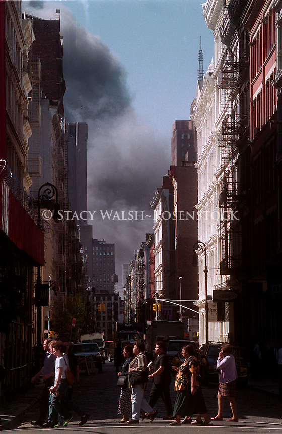 (010911-SWR16.jpg) - New York, NY -- 11 Sept 01 - WORLD TRADE CENTER COLLAPSES AFTER TERRORISTS FLY HYJACKED PLANES INTO TWIN TOWERS - Downtown office workers head east on Houston Street in Soho, evacuating lower Manhattan as the World Trade Center collapses. At approximately 8:42 Eastern Standard Time a hijacked commercial airline crashed into Tower One. Eighteen minutes later a second airplane crashed into the second tower.....© Stacy Walsh Rosenstock.stacy@stacyrosenstock.com.(212) 777 0258