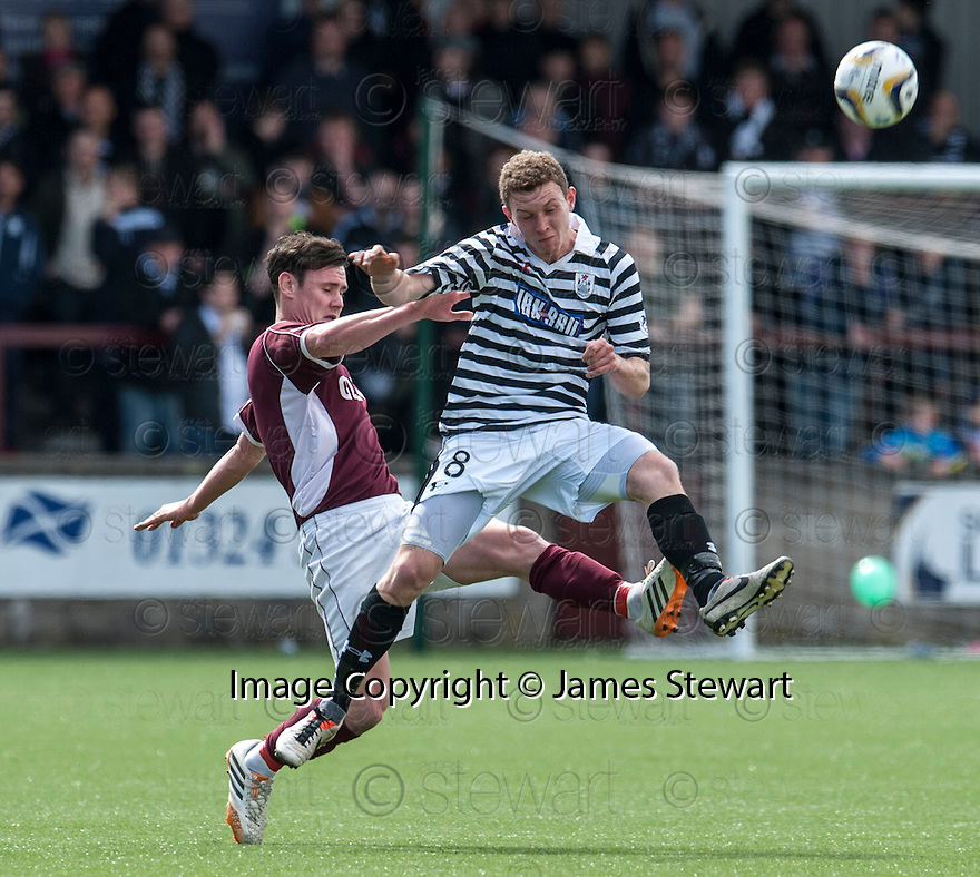Queen Park's Pat Slattery and Stenny's Jamie McCormack challenge for the ball.