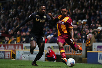 Gavin Massey of Wigan and Tyrell Robinson of Bradford City during the Sky Bet League 1 match between Bradford City and Wigan Athletic at the Northern Commercial Stadium, Bradford, England on 14 March 2018. Photo by Thomas Gadd.
