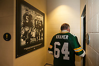 Former Green Bay Packer Jerry Kramer walks past a photo of him, Paul Hornung and Fuzzy Taylor while at Lambeau Field during the game between Seattle Seahawks and the Packers on Sept. 20, 2015.