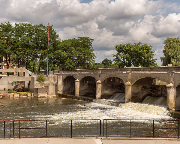 August 5, 2016. Flint, Michigan.<br />  The Flint River as it runs through downtown.<br />  In April 2014, the city of Flint switched its water source from the Detroit Water and Sewerage Department to using the Flint River in an effort to save money. When the switch occurred, the city failed to have corrosion control treatment in place for the new water. This brought about a leaching of lead from pipes into the water, increasing the lead content in the drinking water to levels far above legal limits. After independent sources brought this to light, the city admitted the water was unsafe and legal battles have ensued between resident and the local and state governments.