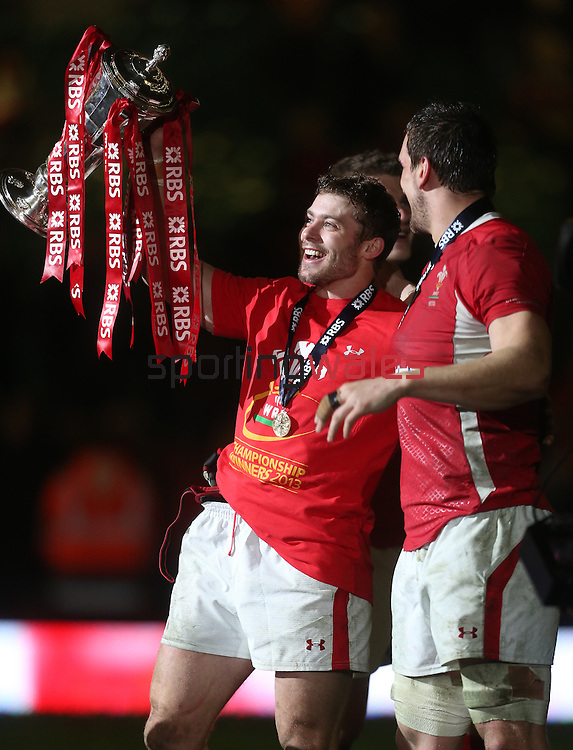 Leigh Halfpenny celebrates with the 6 Nations trophy after Wales retain the title..2013 RBS 6 Nations Championship.Wales v England.Millennium Stadium.16.03.13.Credit: Steve Pope- Sportingwales
