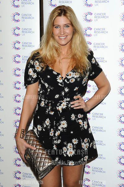 Cheska Hull arriving at James' Jog On To Cancer Event, Kensington Roof Gardens, London. 09/04/2014 Picture by: Alexandra Glen / Featureflash