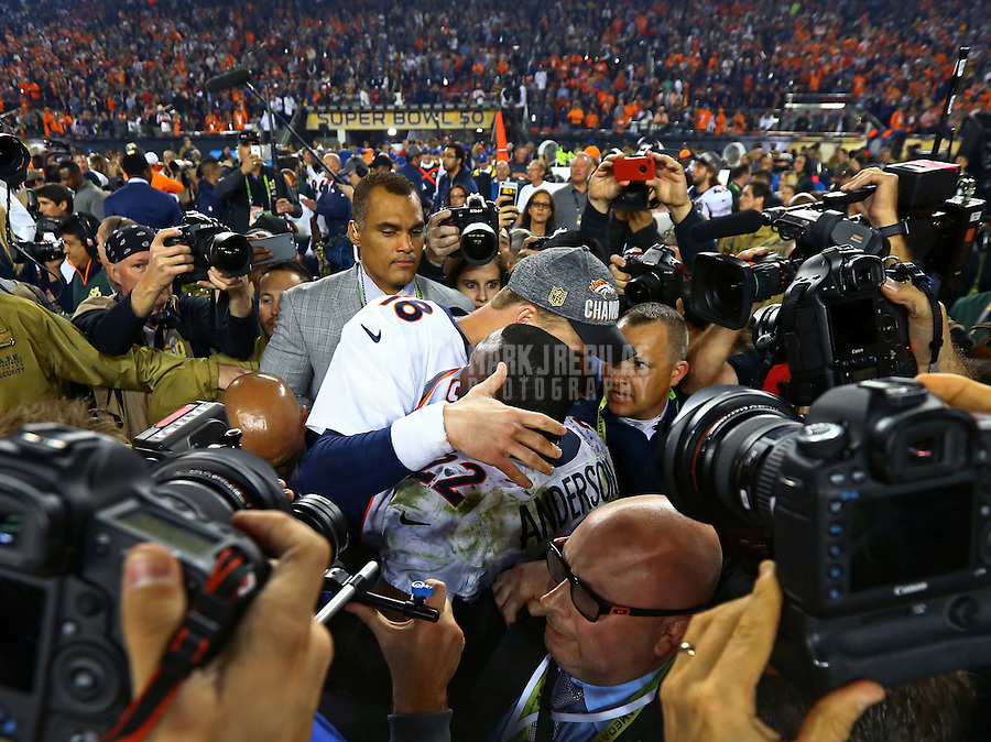 Feb 7, 2016; Santa Clara, CA, USA; Denver Broncos quarterback Peyton Manning (18) embraces running back C.J. Anderson (22) as they celebrate the victory over the Carolina Panthers in Super Bowl 50 at Levi's Stadium. Mandatory Credit: Mark J. Rebilas-USA TODAY Sports