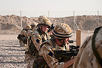 A soldier looks back from a line of British Army parachute engineers taking part in their monthly shooting practice at a range on Shaibah Logistics base.