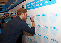 19 April 2017 - Prince Harry meets writes a good luck message as he officially opens the Virgin Money London Marathon Expo at ExCel in London. Prince Harry, who is Patron of the London Marathon Charitable Trust, will meet runners and hand out race numbers, along with special edition Heads Together headbands, which is the official Charity of the Year for this year's marathon. Photo Credit: ALPR/AdMedia
