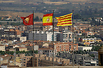 Spanish and Cataluna flags flapping over the roof tops in Lleida, Cataluna, Spain.