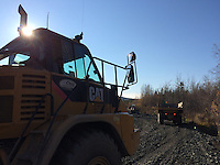 Cruz Construction rock trucks haul material on Tofty Road just outside of Manley Hot Springs, Alaska, in September 2014.