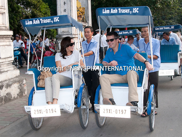 "CROWN PRINCESS MARY AND CROWN PRINCE FREDERIK.take a cyclo tour in a rickshaw in Hanoi, the capital of Vietnam..The Danish Royal Family took in the sights of Hanoi before the start of the State Visit to the Socialist Republic of Vietnam..Prince Henrik, The Prince Consort, showed his family his childhood home at 80 Phan Ding Phung before the start of the cyclo tour_01/11/2009.Mandatory Photo Credit: ©Dias/Newspix International..**ALL FEES PAYABLE TO: ""NEWSPIX INTERNATIONAL""**..PHOTO CREDIT MANDATORY!!: NEWSPIX INTERNATIONAL(Failure to credit will incur a surcharge of 100% of reproduction fees)..IMMEDIATE CONFIRMATION OF USAGE REQUIRED:.Newspix International, 31 Chinnery Hill, Bishop's Stortford, ENGLAND CM23 3PS.Tel:+441279 324672  ; Fax: +441279656877.Mobile:  0777568 1153.e-mail: info@newspixinternational.co.uk"