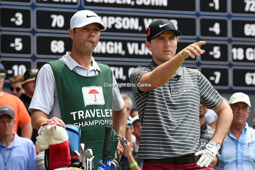 August 6, 2016: Russell Henley discusses his shot off the cart path with his caddy on the 15th hole during day three of the PGA Travelers Championship held at TPC River Highlands in Cromwell CT. Eric Canha/CSM