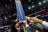 UNITED STATES - AUGUST 30: Massachusetts delegates take their sign after GOP presidential candidate Mitt Romney gives his speech at the 2012 Republican National Convention at the Tampa Bay Times Forum. (Photo By Chris Maddaloni/CQ Roll Call)