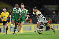 Topsy Ojo of London Irish chips ahead as Charles Piutau of Wasps attempts to block during the Premiership Rugby match between London Irish and Wasps - 28/11/2015 - Twickenham Stadium, London<br /> Mandatory Credit: Rob Munro/Stewart Communications