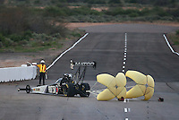Feb 20, 2015; Chandler, AZ, USA; NHRA top fuel driver Antron Brown turns off the track after a run during qualifying for the Carquest Nationals at Wild Horse Pass Motorsports Park. Mandatory Credit: Mark J. Rebilas-